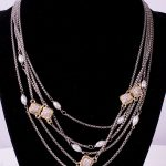 Pearl and crystal clover statement necklace